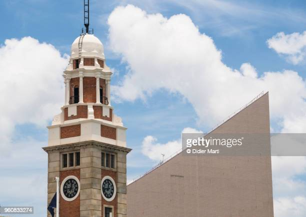 the famous kowloon-canton railway clock tower in tsim sha tsui in hong kong - tsim sha tsui stock pictures, royalty-free photos & images