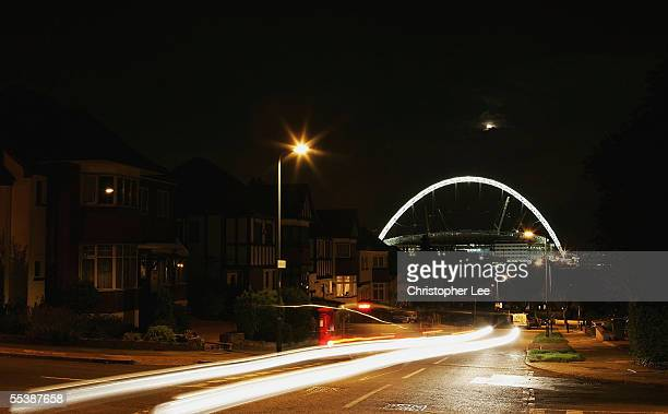 The famous landmark arch of Wembley Football Stadium is lit up to celebrate England Cricket team beating the Australian's to win the Ashes on...