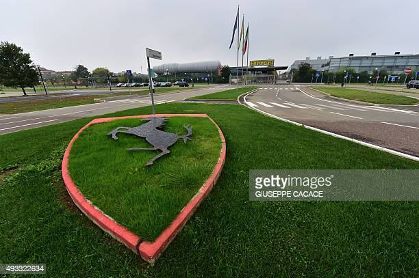 The famous logo of car maker Ferrari representing a prancing horse is pictured in front of the Ferrari factory on October 18 2015 in Maranello Fiat...