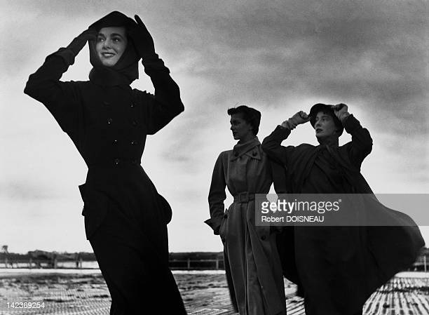 The Famous model Bettina and two other models during a windy fashion shoot for Vogue magazine in September 1949, Robert Doisneau had been working for...