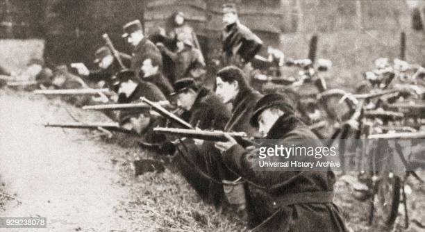 The famous motor cycle corps of Liège, Belgium defend a farm from the advancing Germans in 1914. From The Pageant of the Century, published 1934