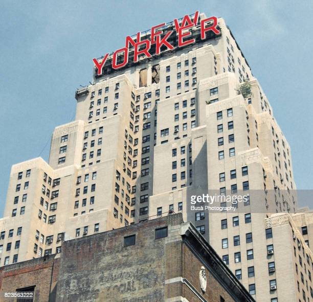 "the famous ""new yorker"" sign on top of the new yorker hotel in midtown manhattan, new york city - new yorker building stock photos and pictures"