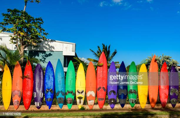 the famous paia surfboard fence. - surfboard stock pictures, royalty-free photos & images
