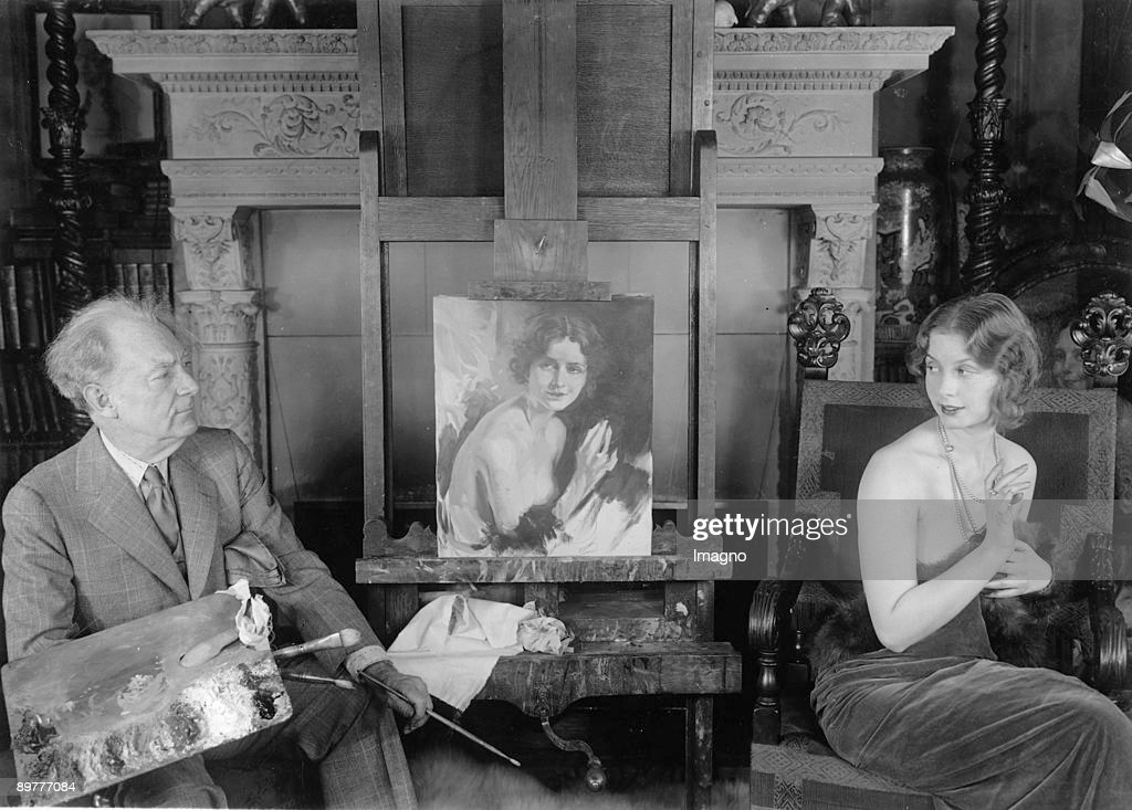 The famous painter Howard Chandler Christy with his model Blanche Satchel. Photograph. Around 1935. : News Photo