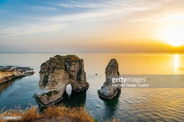 the famous pigeon rock of beirut, lebanon - beirut stock pictures, royalty-free photos & images