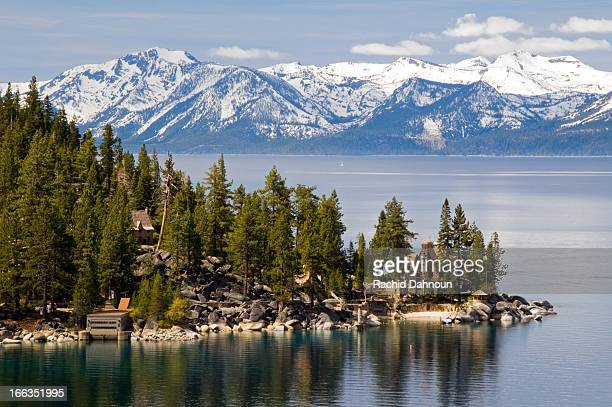 the famous property of the thunderbird lodge is framed by lake tahoe and the snow-capped peaks of the sierra nevada, nv. - lake tahoe stock photos and pictures