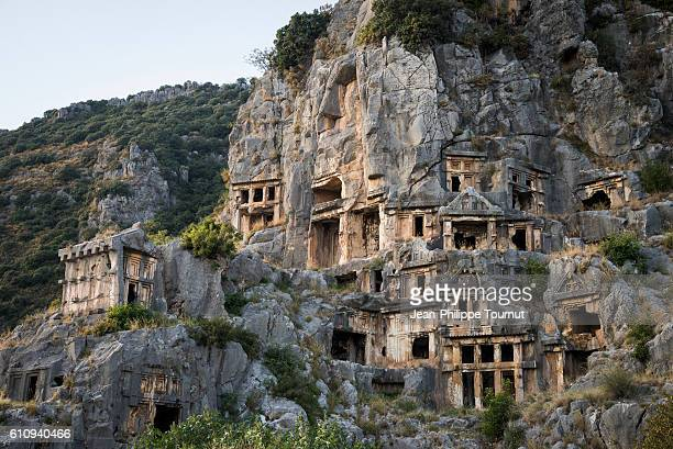 the famous rock tombs of myra carved in a steep cliff, ancient lycian civilisation, southern turkey - empty tomb stock pictures, royalty-free photos & images