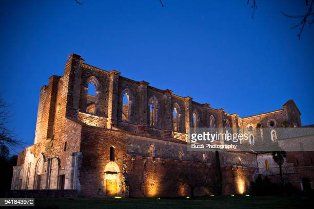 The famous San Galgano Abbey at twilight, in the Siena province, Tuscany, Italy