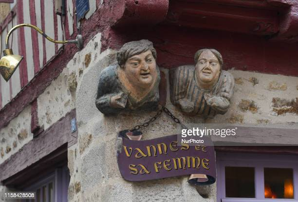 The famous sculpture known as Vannes and his wife with two busts side by side integrated into the facade of a half timbered house of the intramural...