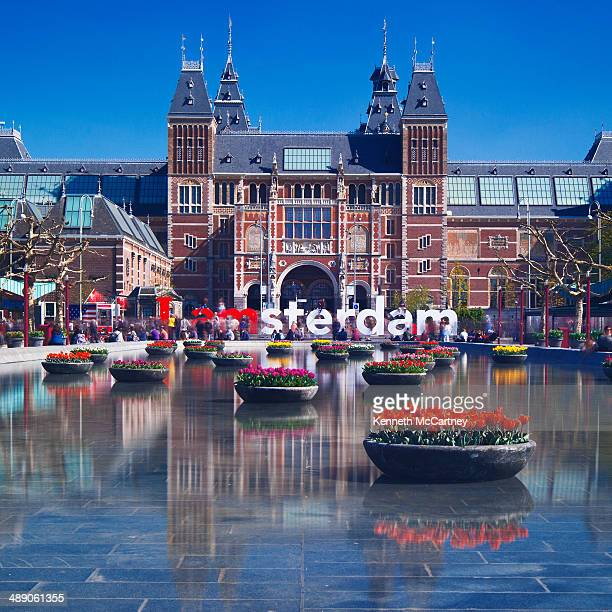 CONTENT] The famous sign underneath the Rijksmuseum as reflected in the pool Seasonal tulips being displayed