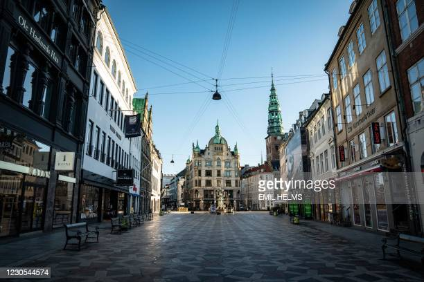 "The famous ""Stroeget"" pedestrian street in Copenhagen, Denmark, is empty during the corona closure, on January 12, 2021. - Responding to a surge in..."