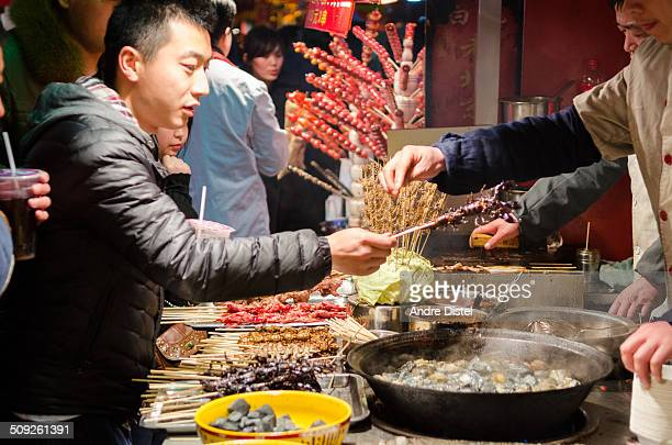 The famous Wangfujing Night Market Vendors selling exotic food to visitors to the market.