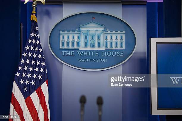 The famous White House logo hangs behind the press secretary's podium in the White House press briefing room