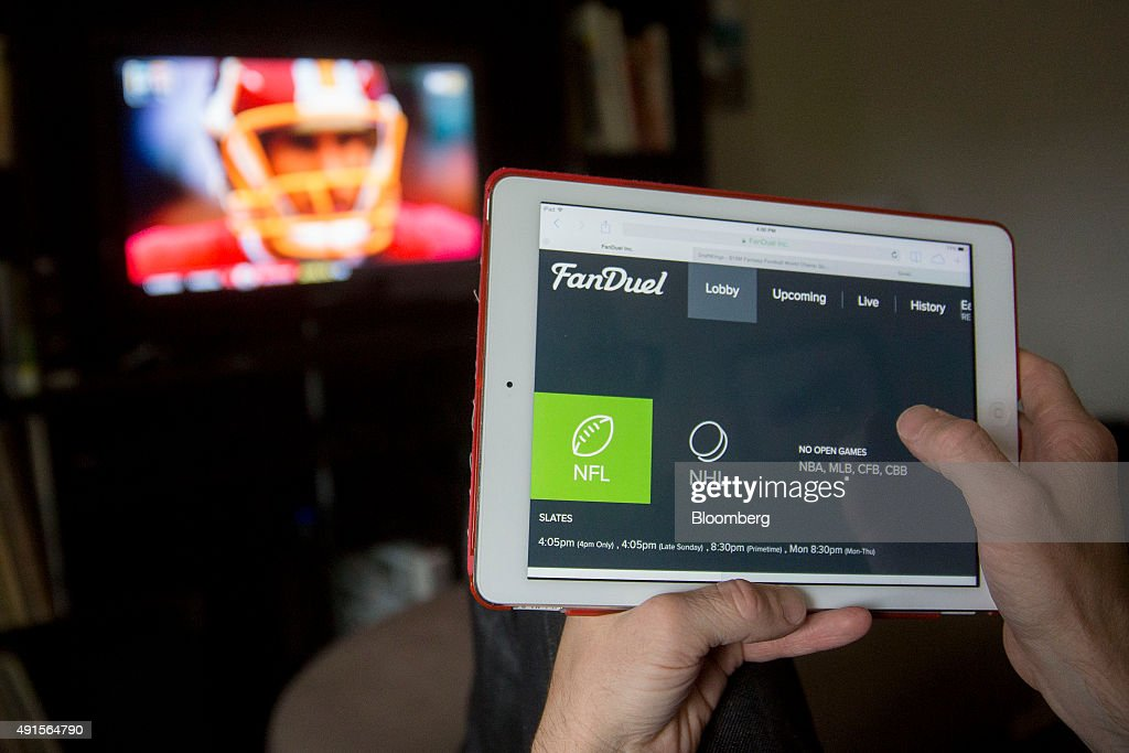 The FanDuel Inc. website is arranged for a photograph on an Apple Inc. iPad in Washington, D.C., U.S., on Sunday, Oct. 4, 2015. Fantasy sports companies DraftKings Inc. and FanDuel Inc. raised a total of $575 million in July from investors including KKR & Co., 21st Century Fox Inc. and Major League Baseball to attract players to games that pay out millions of dollars in cash prizes in daily contests. Photographer: Zia Morales/Bloomberg via Getty Images
