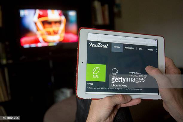 The FanDuel Inc website is arranged for a photograph on an Apple Inc iPad in Washington DC US on Sunday Oct 4 2015 Fantasy sports companies...