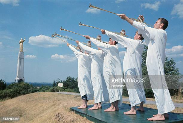 The fanfare of trumpets resounds over the countryside to signal opening of a performance of the Mormon Pageant on Hill Cumorah These trumpeters are...