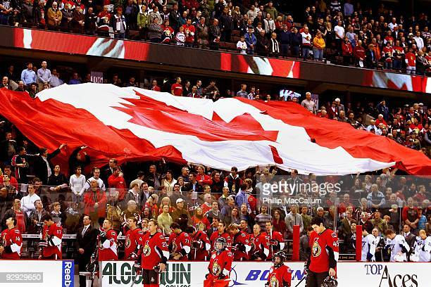 The fans at Scotiabank Place pass around a giant Canadian Flag through the stands during the national anthem before a game between the Tampa Bay...