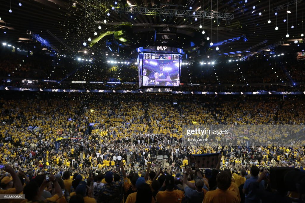 The fans celebrate after the Golden State Warriors win the NBA Championship defeating the Cleveland Cavaliers in Game Five of the 2017 NBA Finals on June 12, 2017 at ORACLE Arena in Oakland, California.