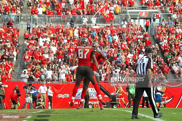 The fans celebrate the Buccaneers offense after a touchdown as Jameis Winston of the Bucs celebrates with Austin SeferianJenkins 87 during the NFL...