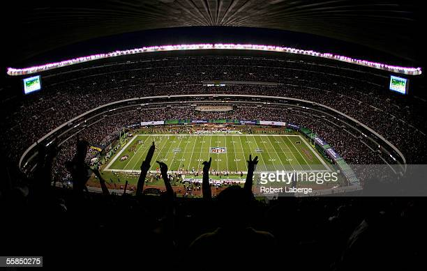 The fans cheer as the San Francisco 49ers score their first touchdown during the NFL game against the Arizona Cardinals at Estadio Azteca in Mexico...