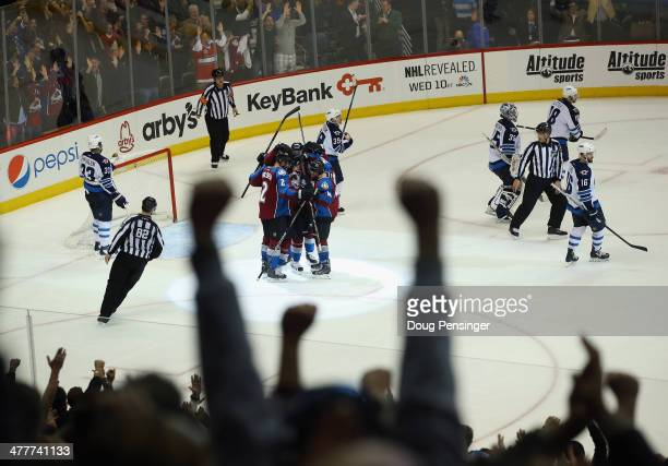 The fans join the celebration after Matt Duchene of the Colorado Avalanche scored the game winning goal in overtime against goalie Al Montoya of the...