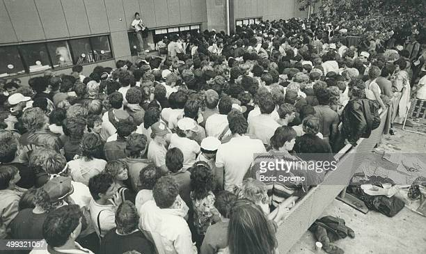 The fans lined up: Thousands who wanted tickets to see Bruce Springsteen; shown in inset at his CNE concert last summer; had to line up at Exhibition...