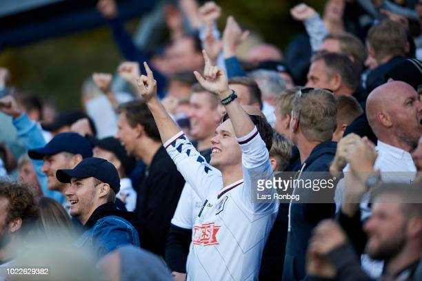 The fans of AGF Aarhus cheer during the Danish Superliga match between Hobro IK and AGF Aarhus at DS Arena on August 24 2018 in Hobro Denmark