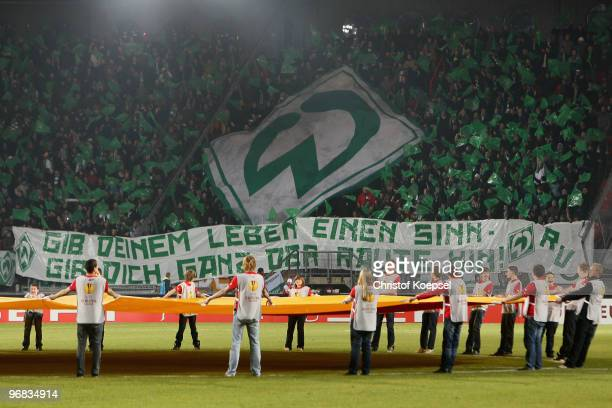 The fans of Bremen show a banner during the UEFA Europa League knockout round first leg match between FC Twente Enschede and SV Werder Bremen at De...