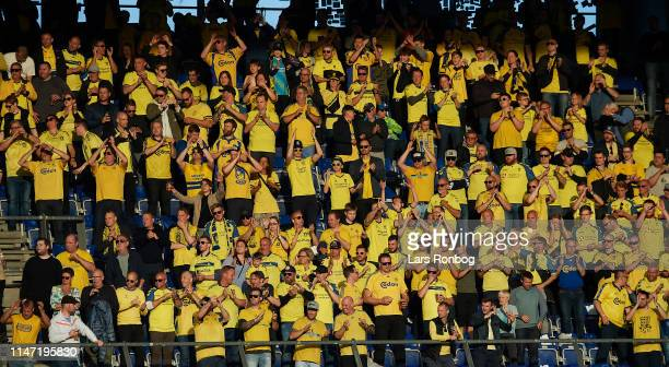 The fans of Brondby IF cheer during the Danish Superliga Europa League Playoff match between Brondby IF and Randers FC at Brondby Stadion on May 31,...