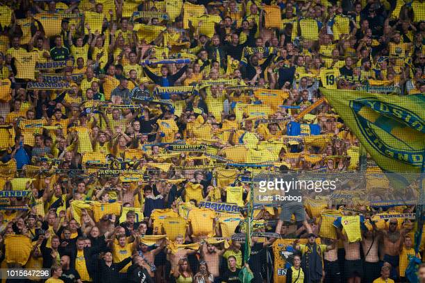 The fans of Brondby IF cheer during the Danish Superliga match between FC Copenhagen and Brondby IF at Telia Parken Stadium on August 12 2018 in...