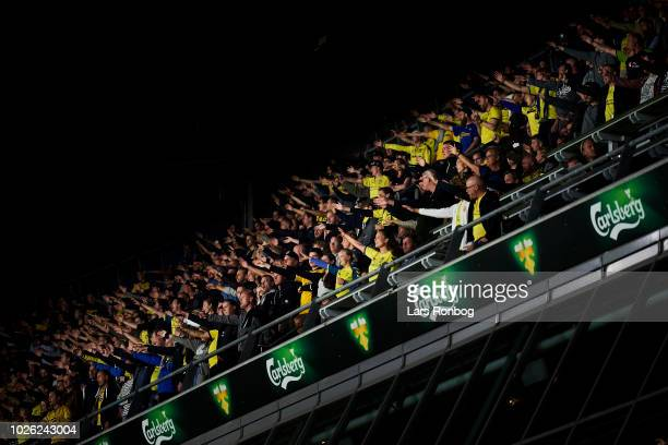 The fans of Brondby IF cheer during the Danish Superliga match between Brondby IF and FC Midtjylland at Brondby Stadion on September 2, 2018 in...