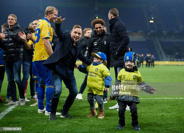 The fans of Brondby IF cheer with Uffe Bech of Brondby IF after the Danish Superliga match between Brondby IF and AGF Aarhus at Brondby Stadion on...
