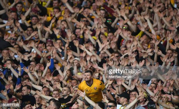 The fans of Dynamo Dresden seen during the Second Bundesliga match between VfB Stuttgart and Dynamo Dresden at Mercedes-Benz Arena on April 2, 2017...