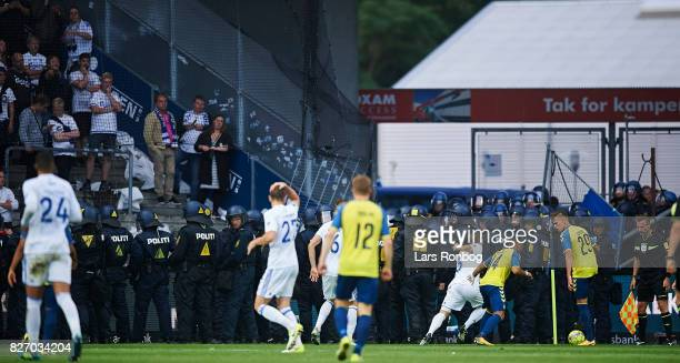 The fans of FC Copenhagen and the police during the Danish Alka Superliga match between Brondby IF and FC Copenhagen at Brondby Stadion on August 6...