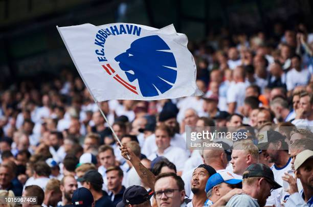 The fans of FC Copenhagen cheer with a flag during the Danish Superliga match between FC Copenhagen and Brondby IF at Telia Parken Stadium on August...
