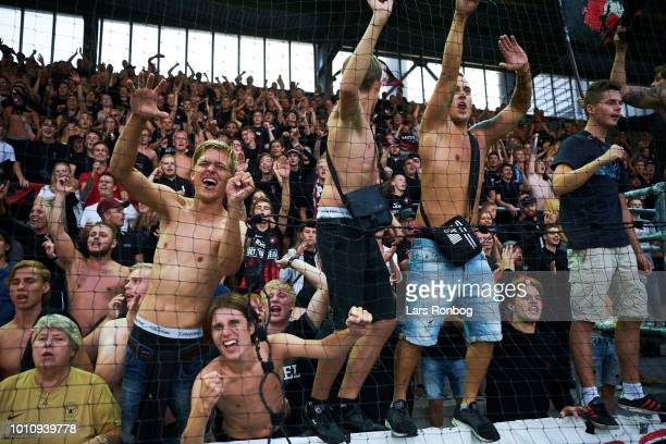 The fans of FC Midtjylland cheer after the Danish Superliga match between Vejle Boldklub and FC Midtjylland at Vejle Stadion on August 4 2018 in...