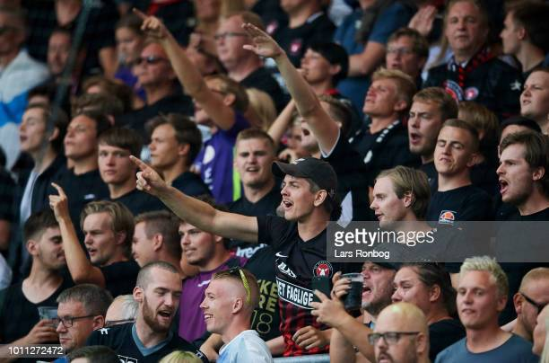 The fans of FC Midtjylland cheer during the Danish Superliga match between Vejle Boldklub and FC Midtjylland at Vejle Stadion on August 4 2018 in...