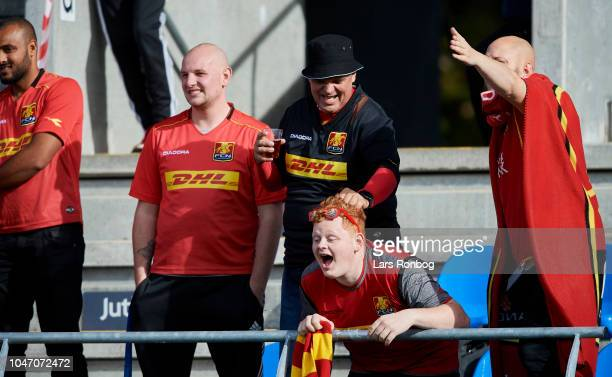 The fans of FC Nordsjalland cheer during the Danish Superliga match between Hobro IK and FC Nordsjalland at DS Arena on October 7, 2018 in Hobro,...