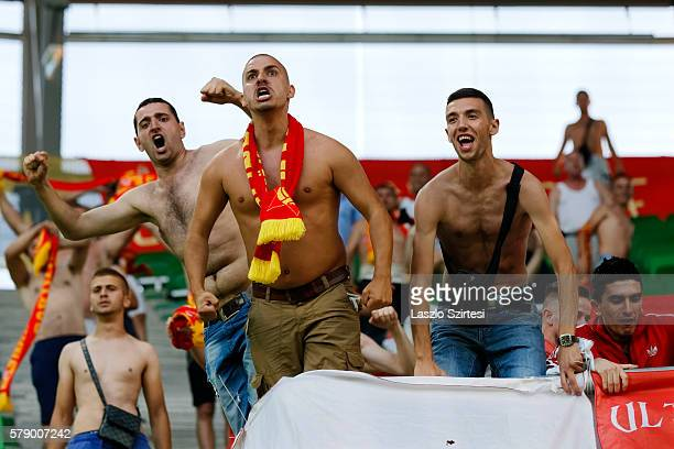 The fans of FK Partizani celebrate the equalizer goal during the UEFA Champions League Qualifying Round match between Ferencvarosi TC and FK...