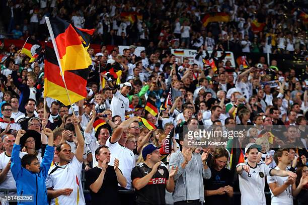The fans of Germany celebrate a goal during the FIFA 2014 World Cup Qualifier group C match between Germany and Faeroe Islands at AWD Arena on...