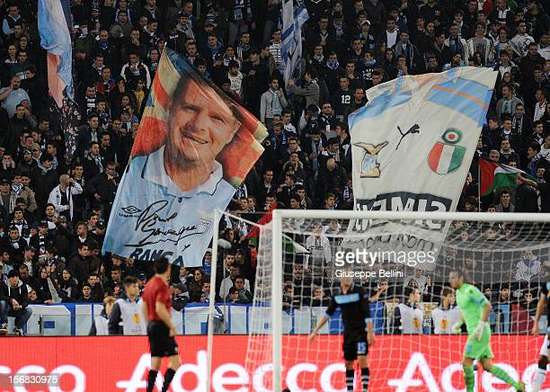 The fans of Lazio hold up a banner featuring former player Paul Gascoigne during the UEFA Europa League Group J match between SS Lazio and Tottenham...