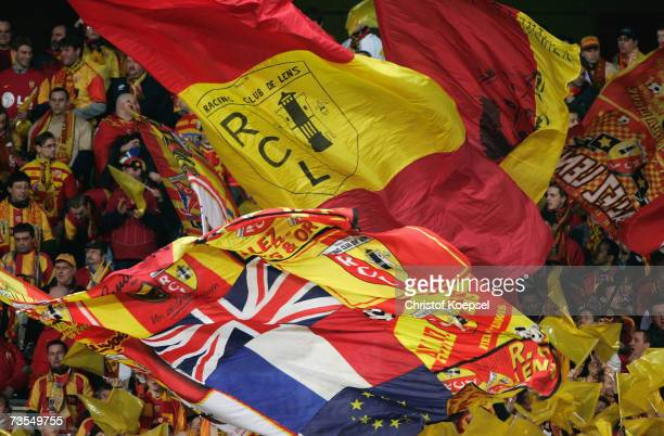 The fans of Lens wave the flags during the UEFA Cup round of sixteen first leg match between RC Lens and Bayer Leverkusen at the Stade FelixBollaert...
