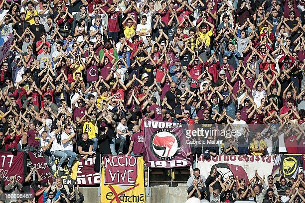 The fans of Livorno cheer during the Serie A match between AS Livorno Calcio and Atalanta BC at Stadio Armando Picchi on November 3 2013 in Livorno...