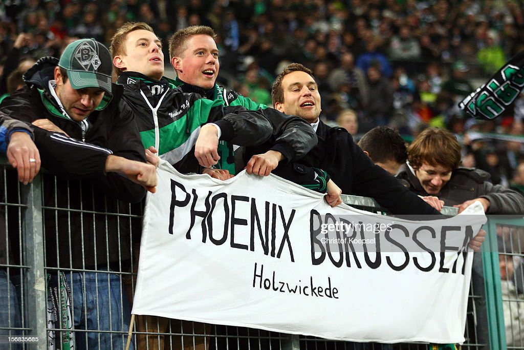 The fans of Moenchengladbach celebrate after the UEFA Europa League group C match between Borussia Moenchengladbach and AEL Limassol FC at Borussia Park Stadium on November 22, 2012 in Moenchengladbach, Germany. The match between Moenchengladbach and Limassol ended 2-0.
