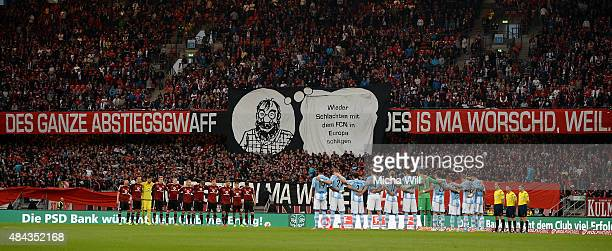 The fans of Nuernberg pause for a minutes silence at the beginning of the second Bundesliga match between 1 FC Nuernberg and TSV 1860 Muenchen at...