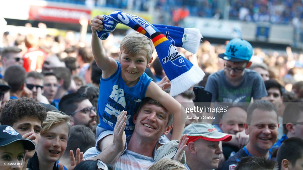 The Fans of Paderborn celebrate after the 3. Liga match between SC Paderborn 07 and SpVgg Unterhaching at Benteler Arena on April 21, 2018 in Paderborn, Germany.