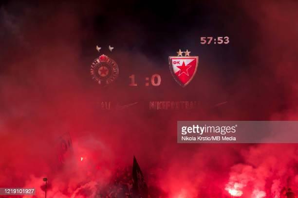 The fans of Partizan Belgrade light flares after Bibars Natho of Partizan scores for 10 during the Semifinal Serbian Cup match between Red Star...