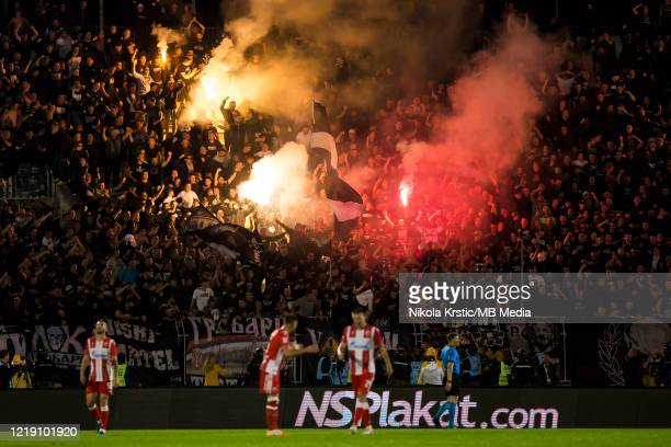 The fans of Partizan Belgrade light flares during the Semifinal Serbian Cup match between Red Star Belgrade and Partizan Belgrade at Partizan Stadium...