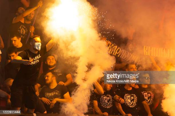 The fans of Partizan light flares during the final Supercup match on June 24 2020 in Nis Serbia