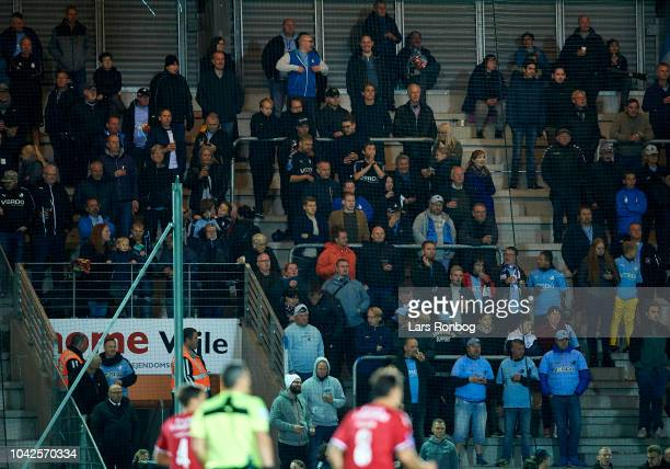 The fans of Randers FC cheer during the Danish Superliga match between Vejle Boldklub and Randers FC at Vejle Stadion on September 28 2018 in Vejle...